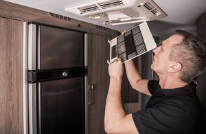 Professional cleaning air ducts in a home