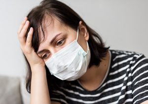 Woman suffering from allergies due to unclean air ducts